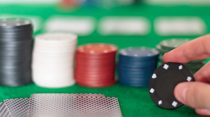 Poker cards and chips on table