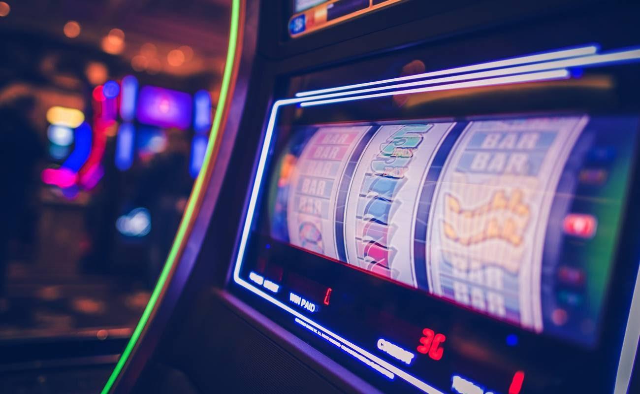 Blurred image of slot machine in casino with neon lighting