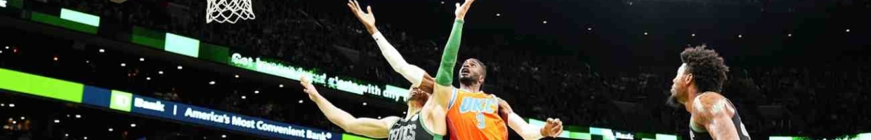OKC vs Celtics basketball match with players jumping for the ball