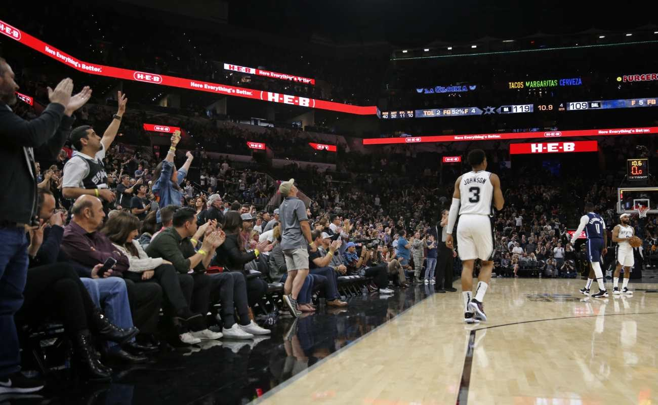 NBA match with fans applauding players