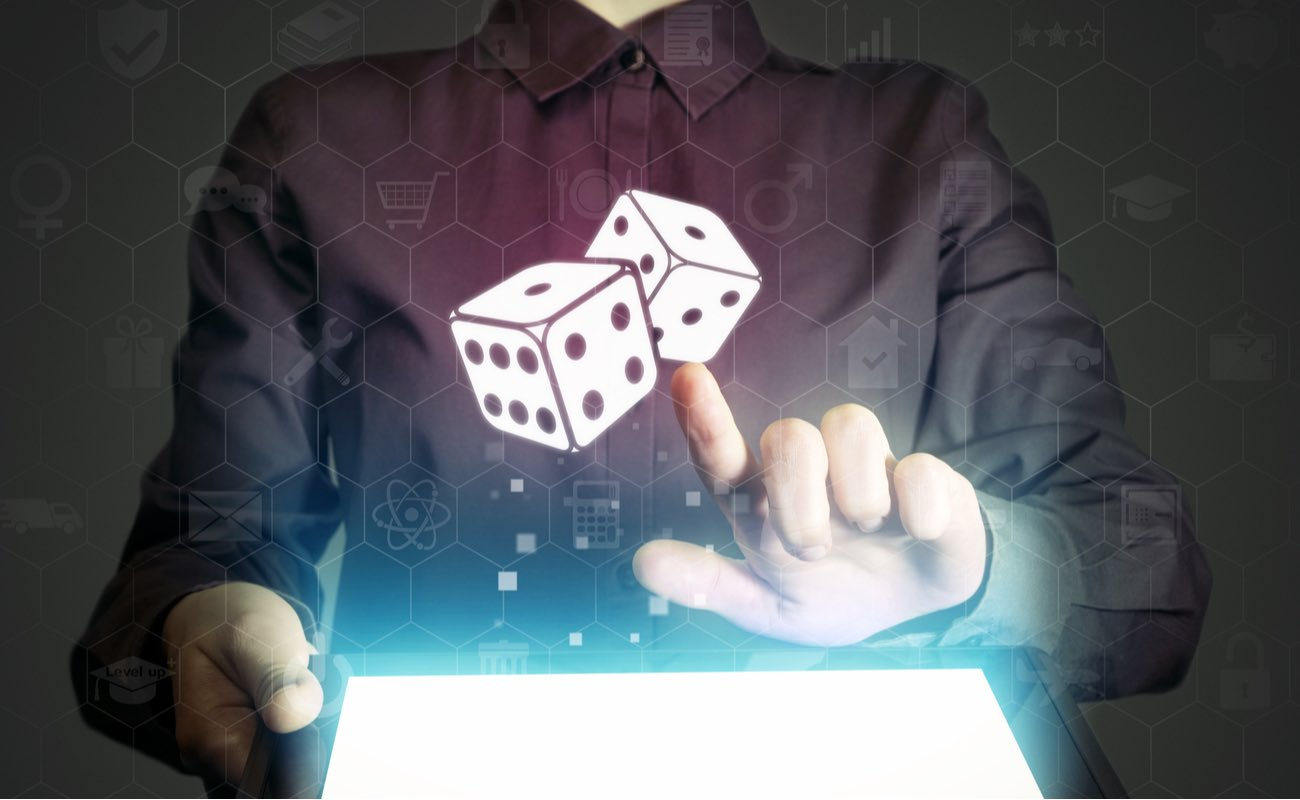 Casino waitress holding a tablet showing a virtual and dice icon