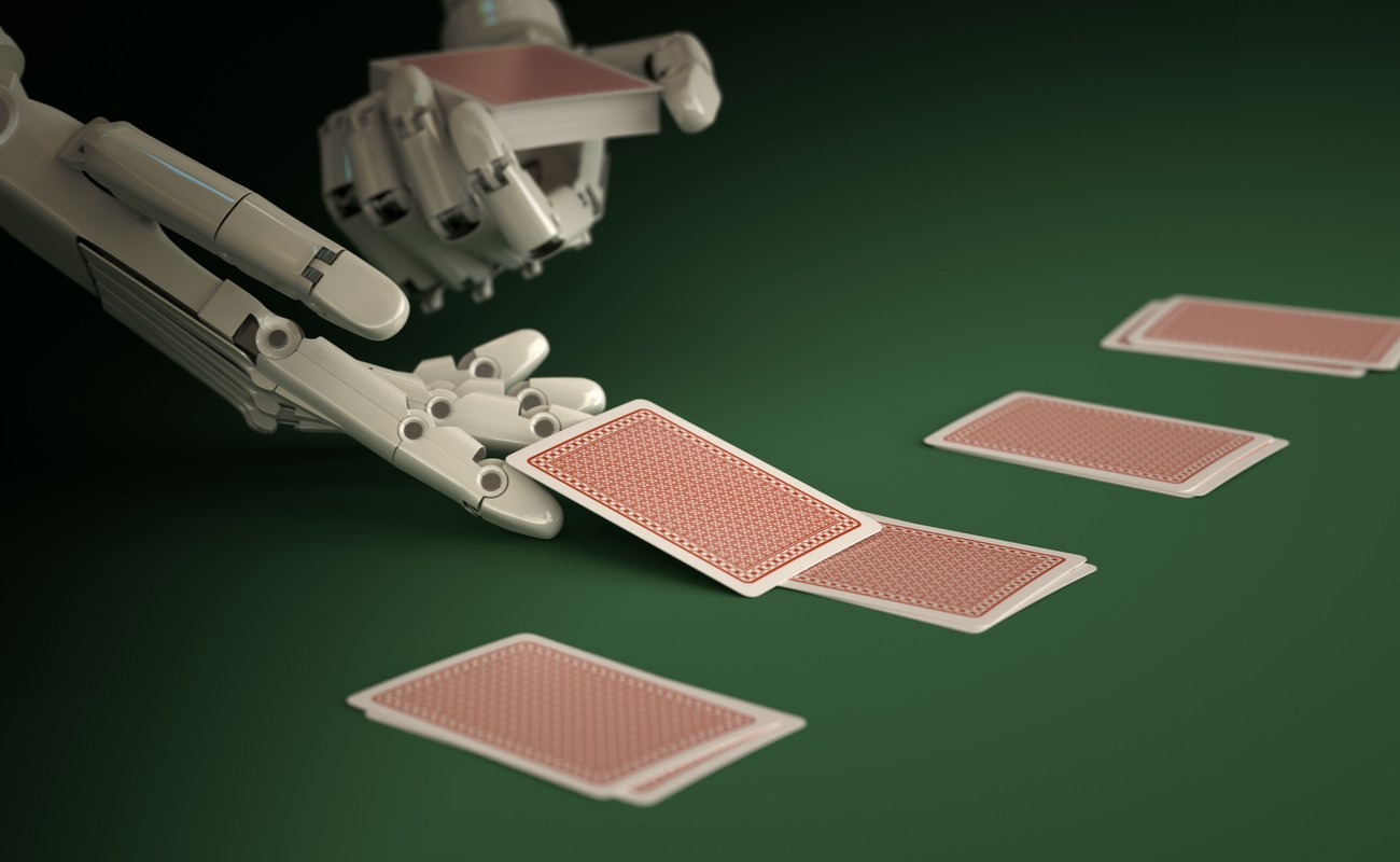 Robot croupier dealing cards on green felt casino table