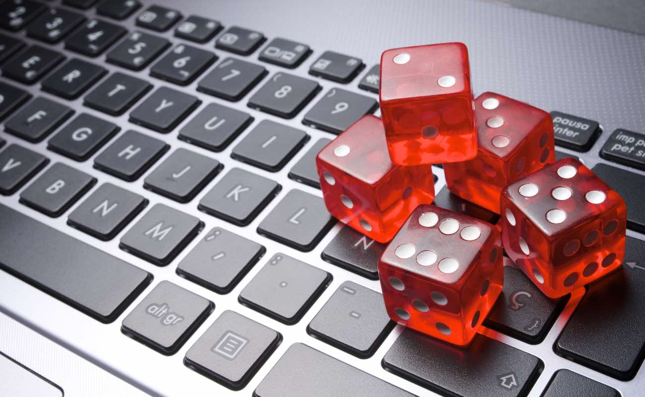 Close up of a stack of red dice on laptop keyboard