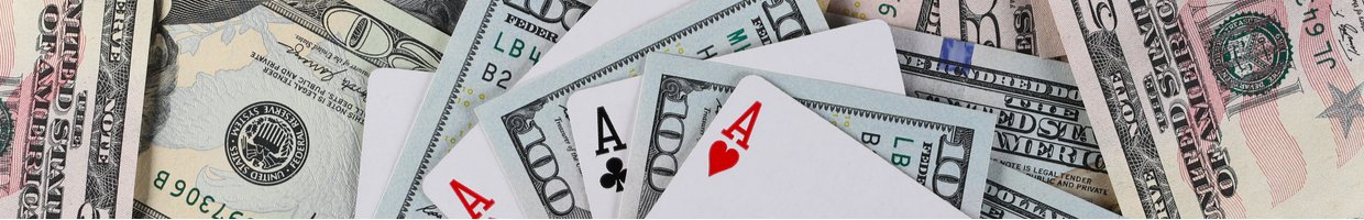 American dollar banknotes with playing cards