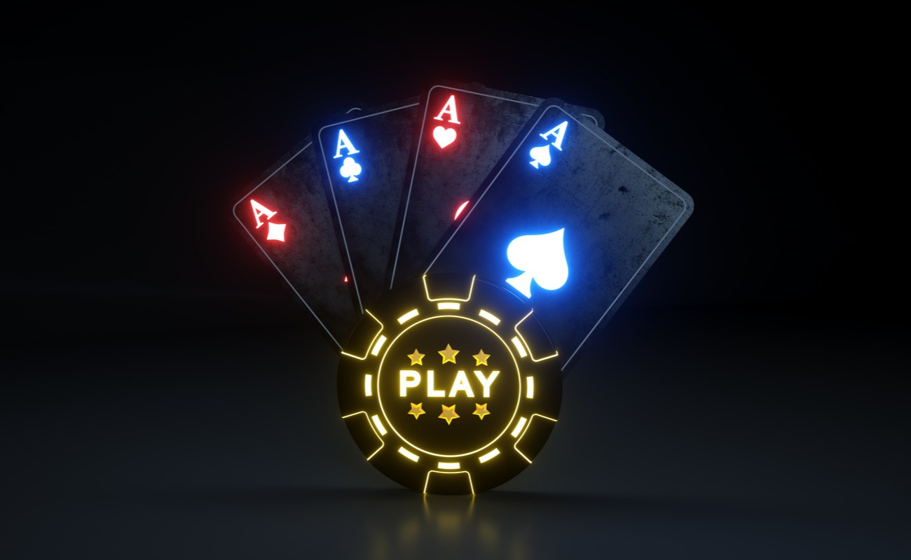 Lit up gaming chip with the word play on it with lit up hand of aces