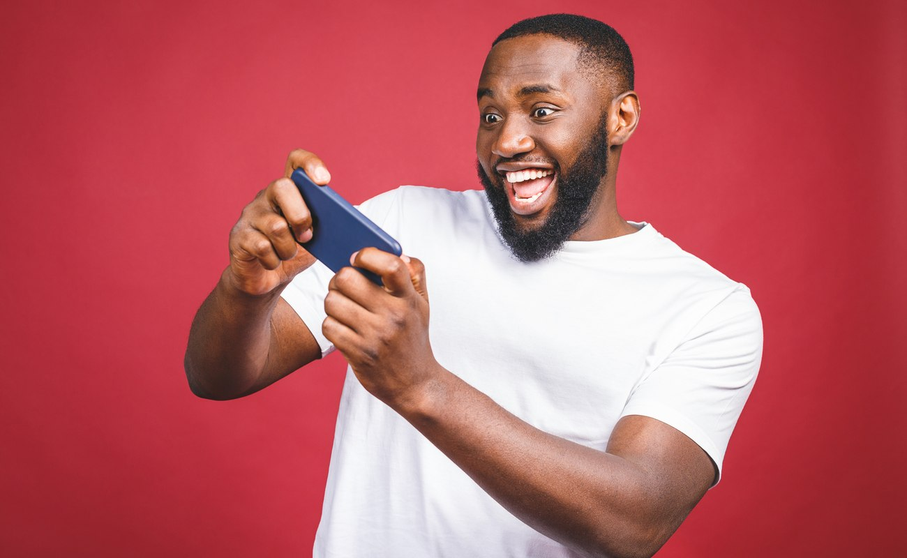 A man is excited while playing a mobile game