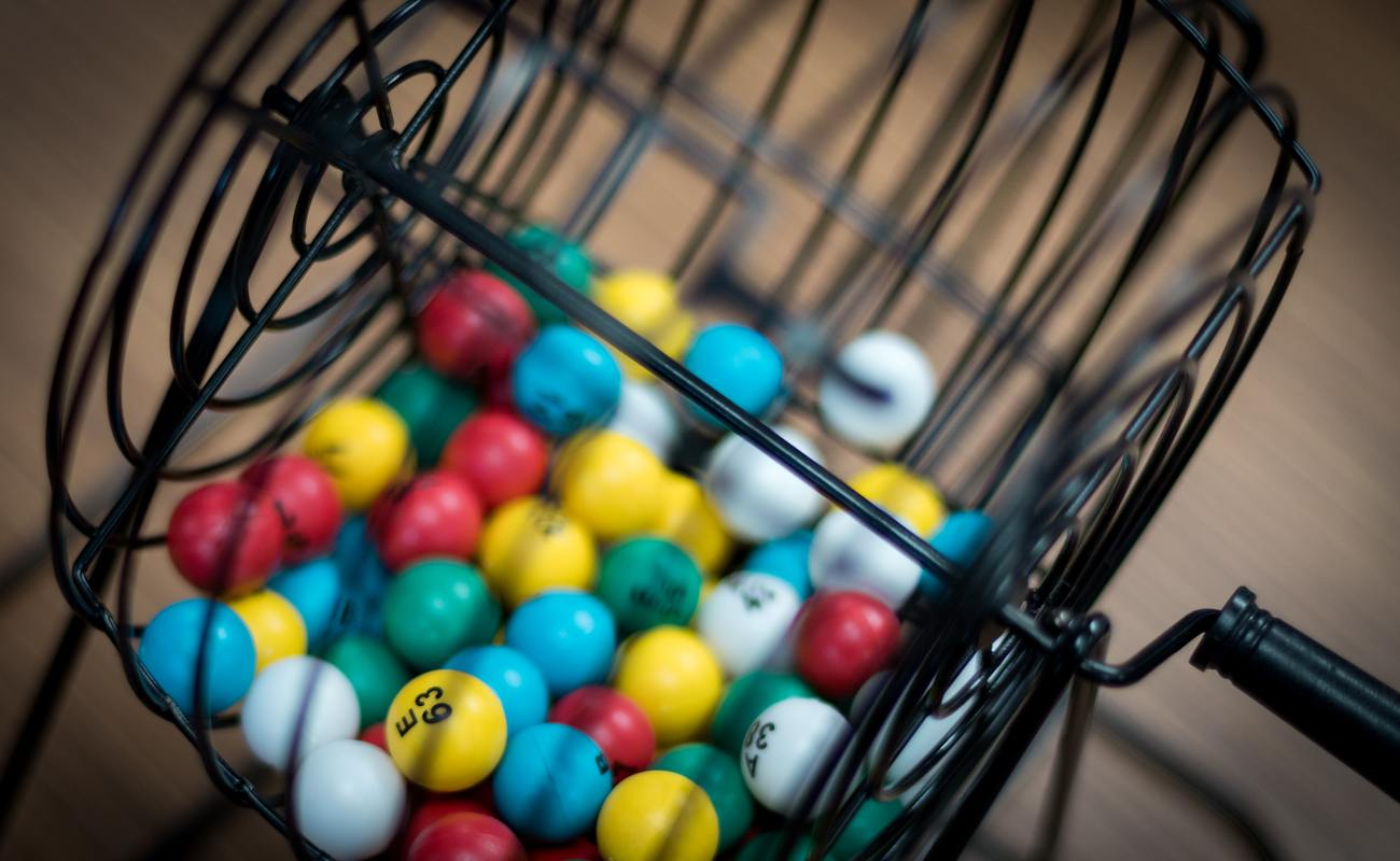 A close-up of a bingo cage filled with numbered bingo balls.