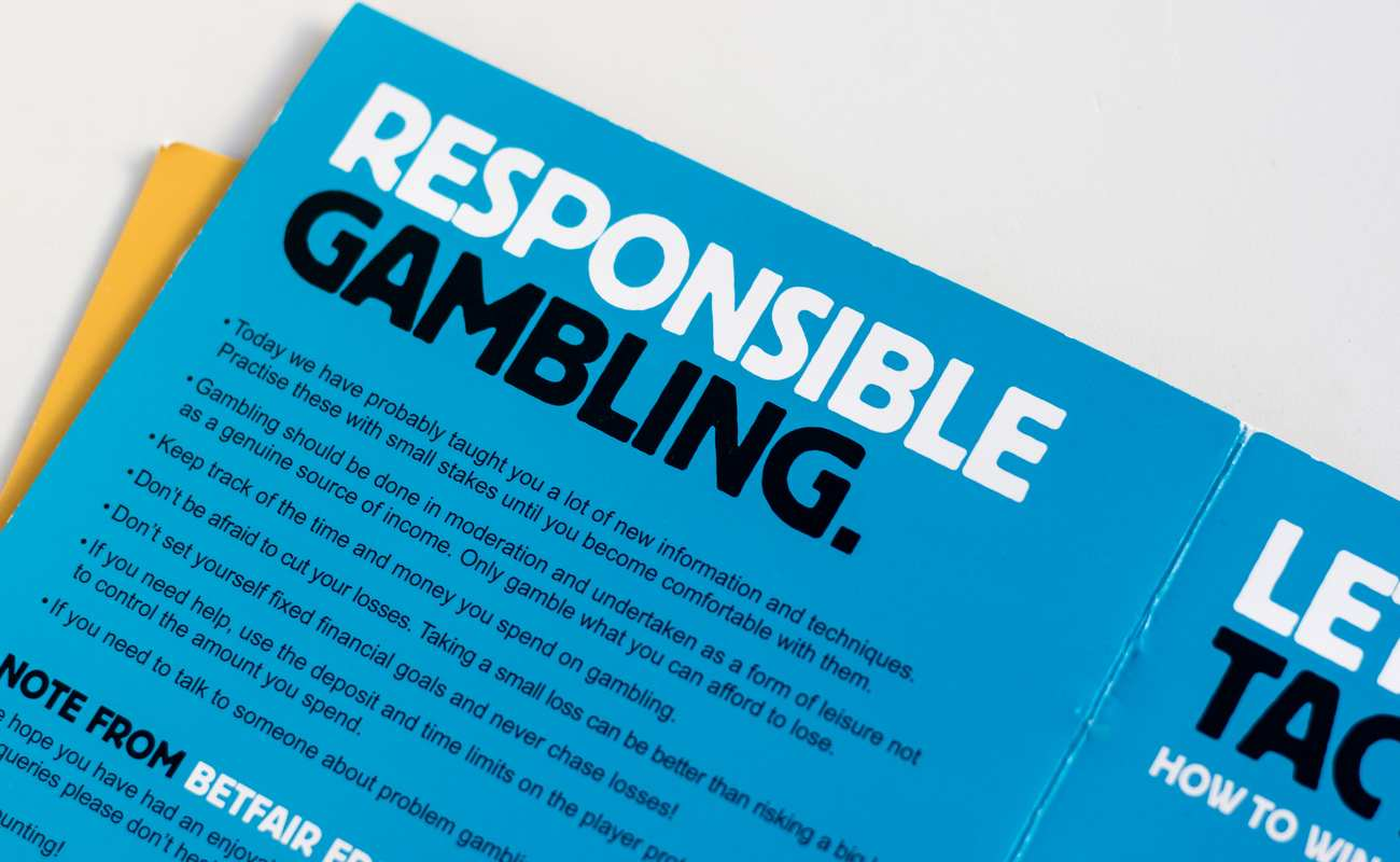 A Blue Responsible Gambling Pamphlet on a White Background