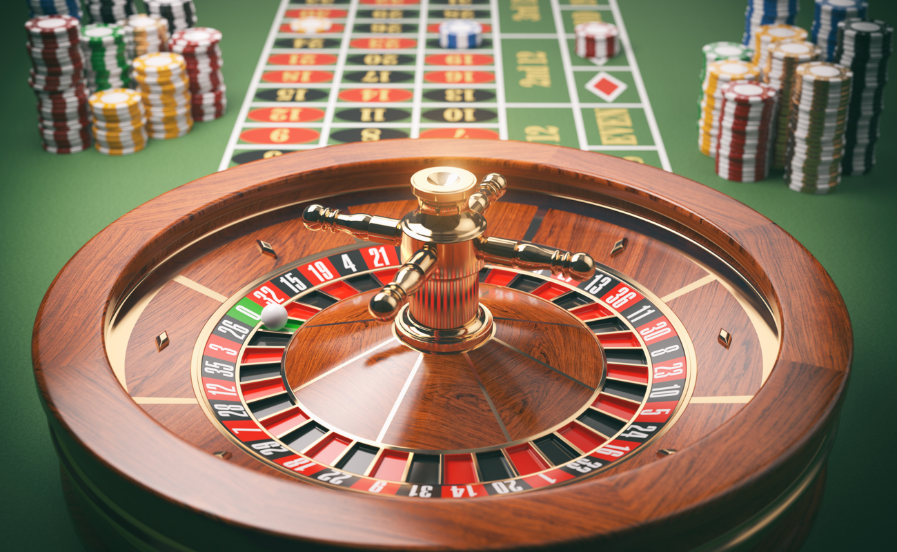 Wooden casino roulette wheel with gold accents on green felt.