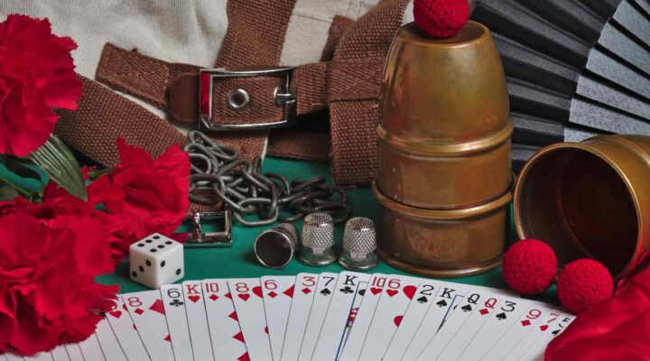 Playing cards and dice on a green felt table.