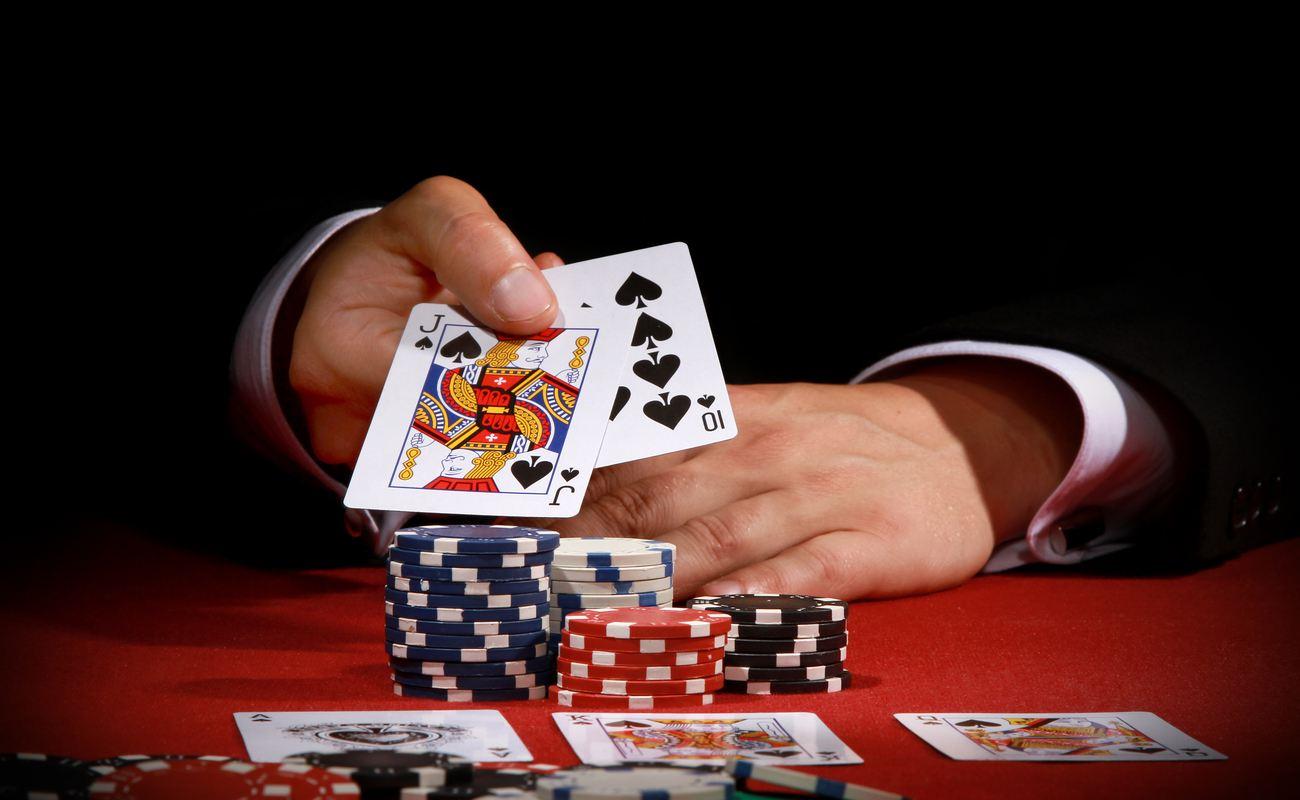 A man reveals his poker hand.