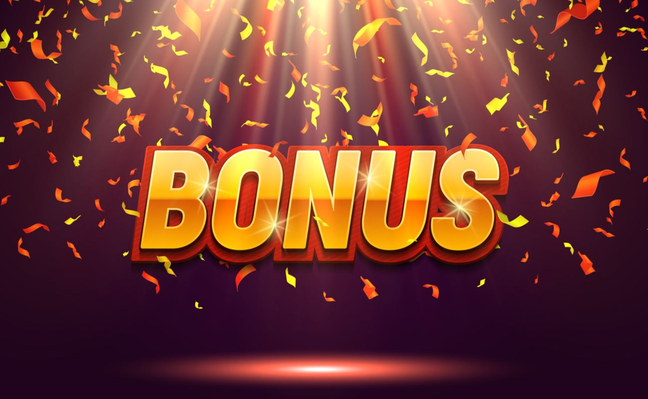 An illustration of the word 'bonus' is seen sitting in the center of a spotlight while confetti falls down around it.