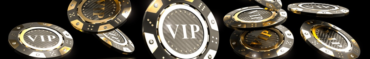 """Casino chips with the word """"VIP"""", seen falling down as if scattered."""