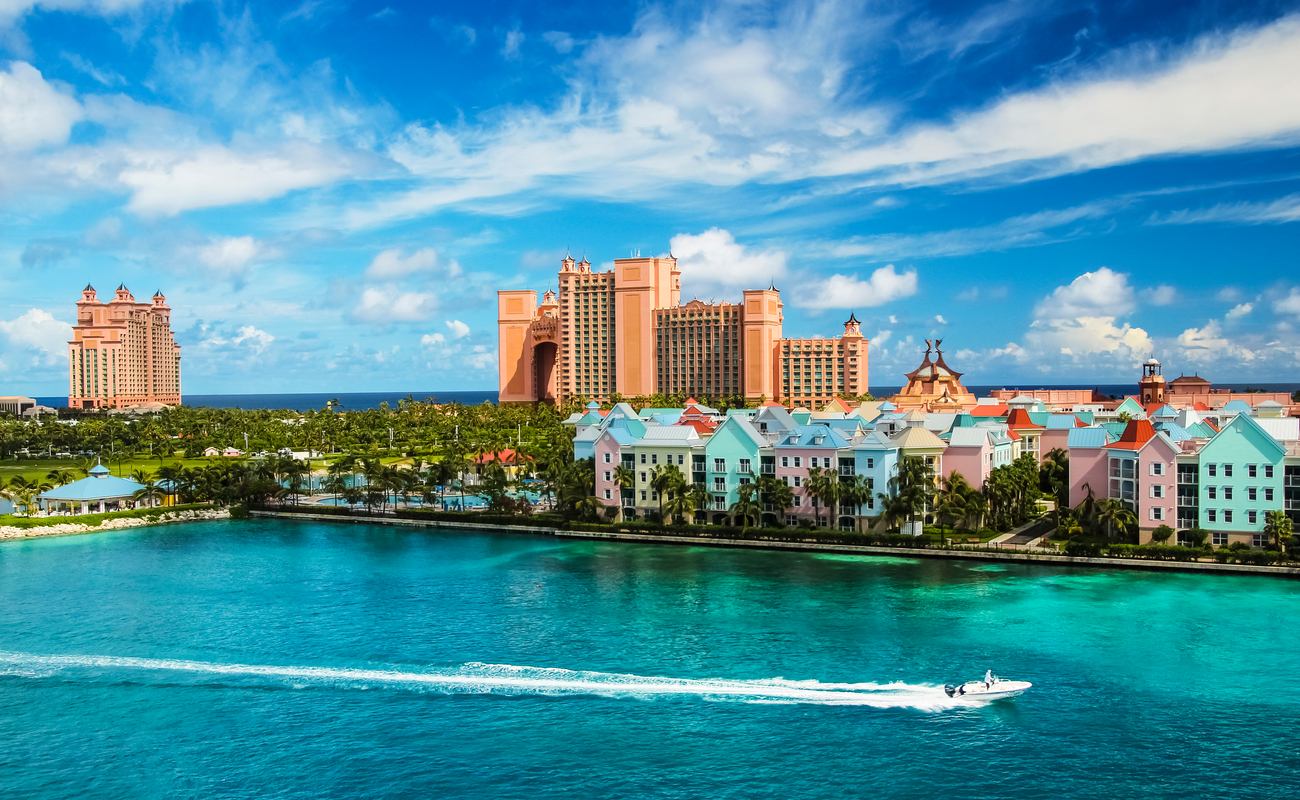 Scenery of a hotel, boat, houses and the ocean at Nassau, Bahamas.