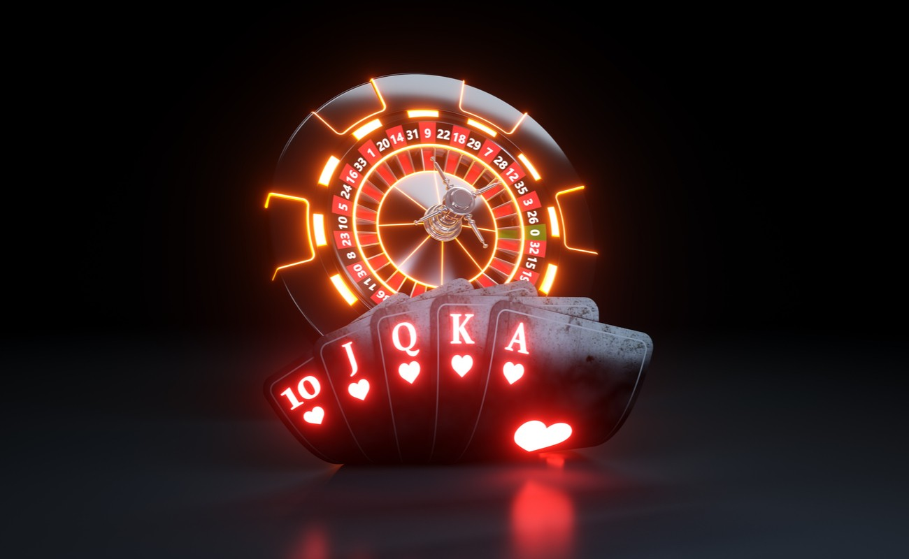Neon lit casino games concept with hand of cards and roulette wheel