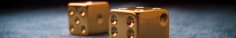 Lucky gold dice on billiard table felt