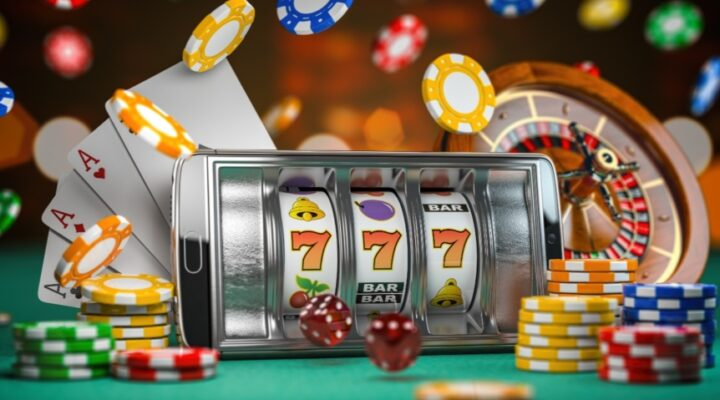 3D illustration of a slot machine, dice, cards and roulette on a green table.