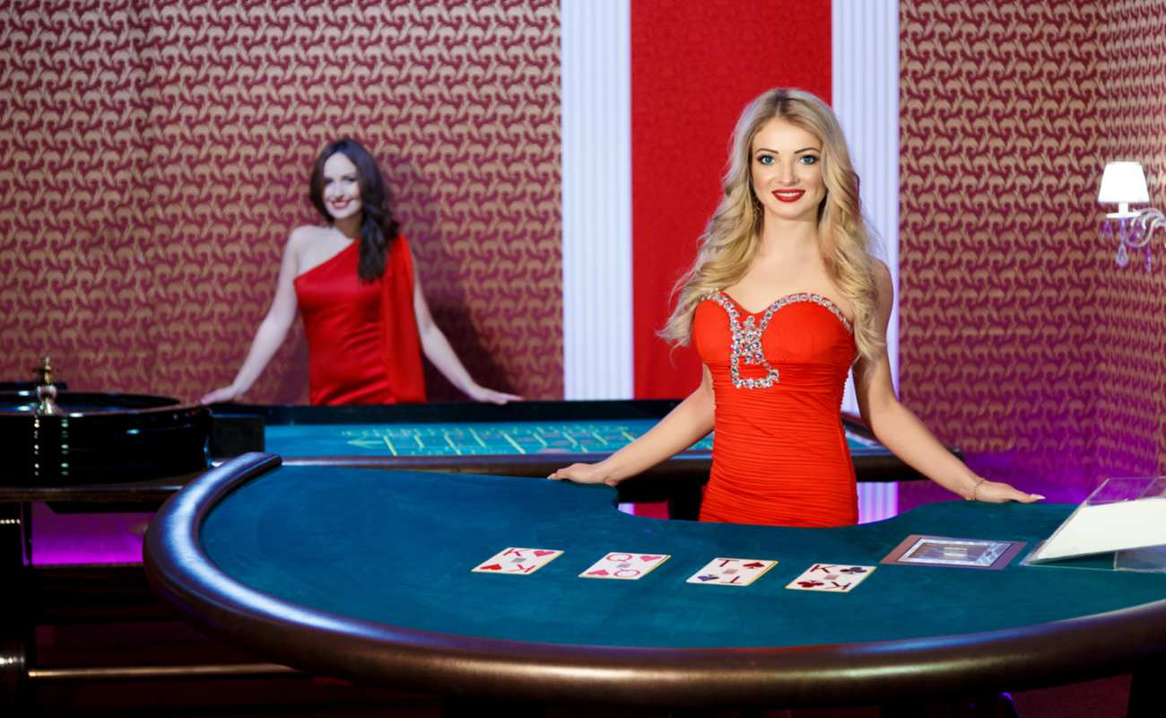 Two live dealer casino game hosts are ready to start their games.