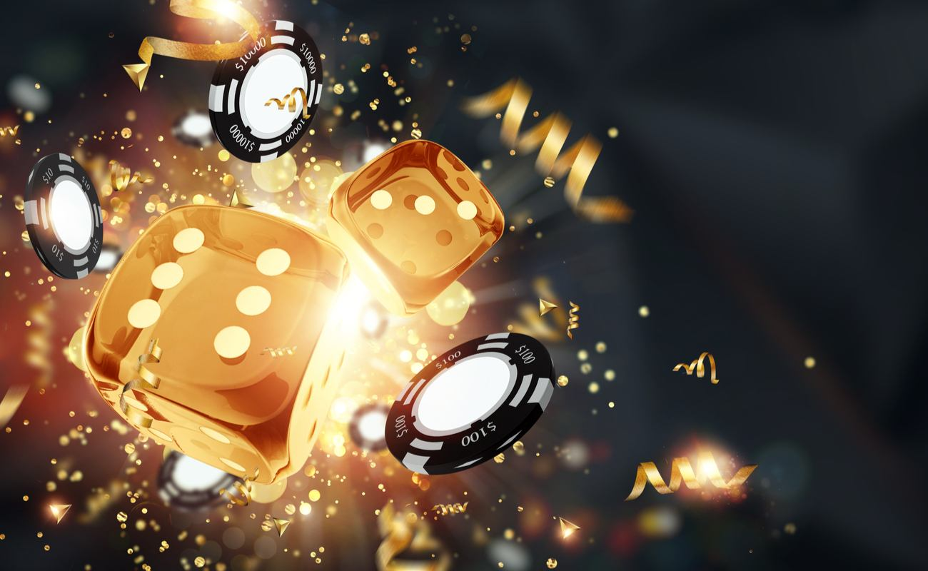 A group of golden dice and black casino chips fly away from a bright light.
