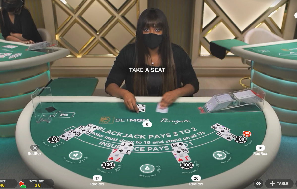 Private live blackjack green table with woman working on it