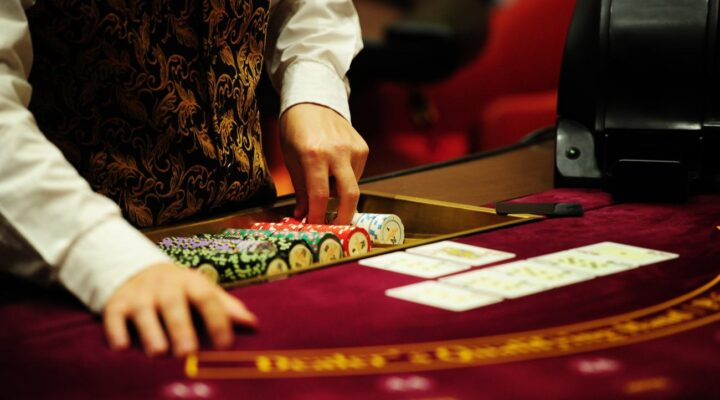 Dealer taking chips out out the tray at a casino table