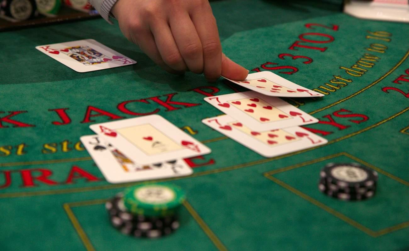 Dealer placing cards down on blackjack table