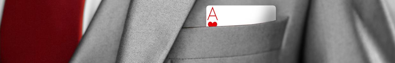 An ace card sticking out a business jacket pocket.