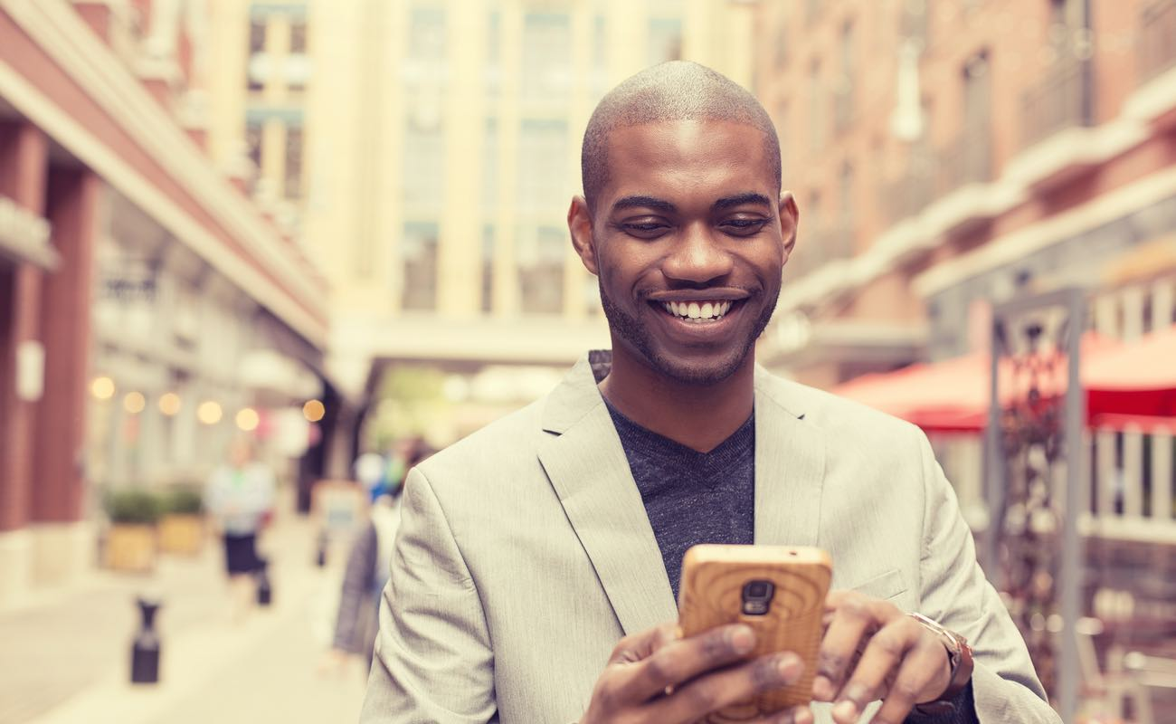 Young professional man using a smartphone in the city.