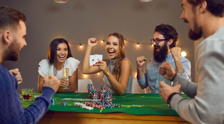 A woman celebrates her win at a casino party.