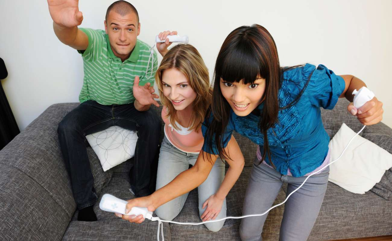 A group of friends playing Wii Sports together.