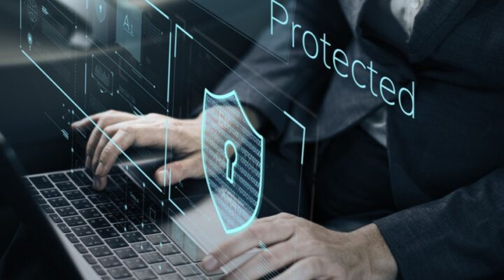A rendering of a lock above a laptop indicates it is secure and protected.