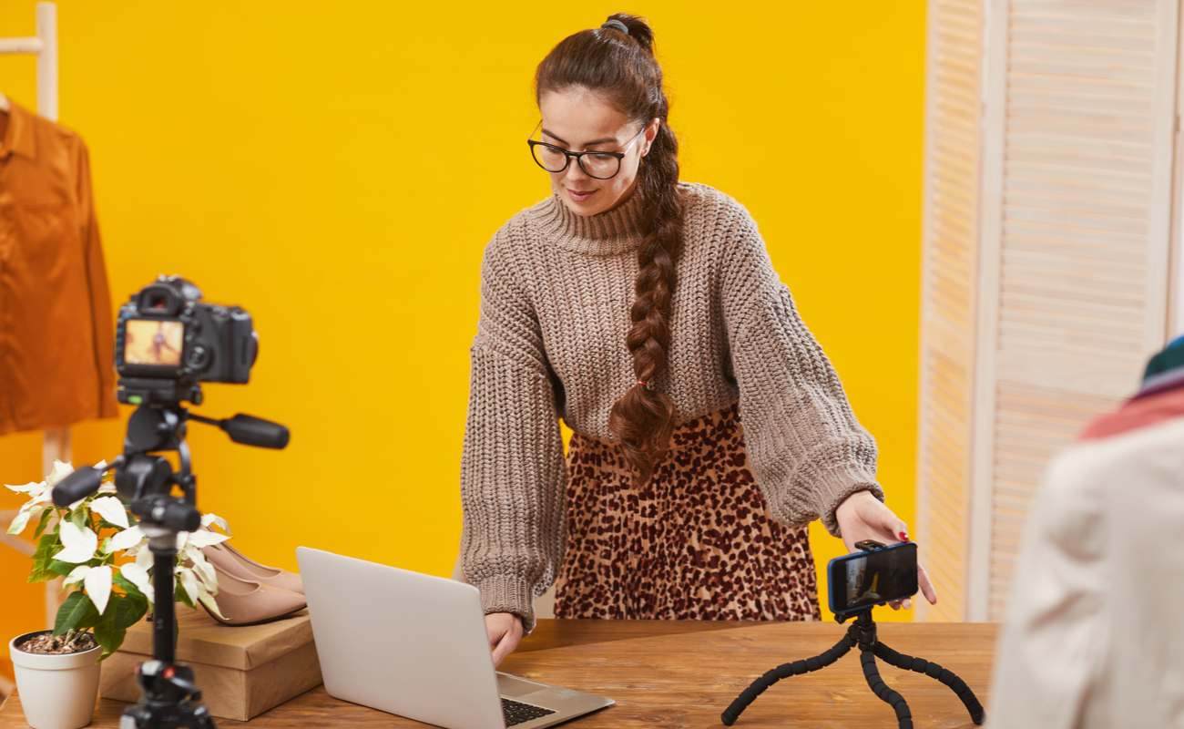 A woman configures her cameras for her live stream.