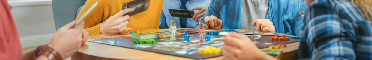 Friends playing a board game on a table.