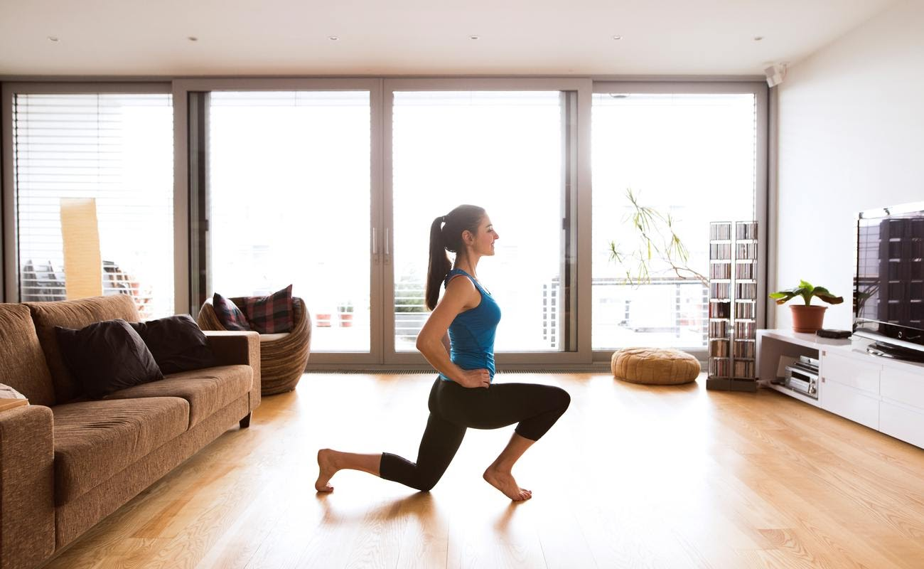 A girl exercising in her apartment.