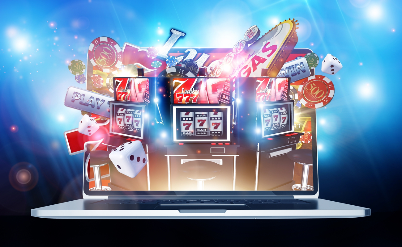Illustration showing online slots and gambling paraphernalia bursting out of the screen of a laptop computer.