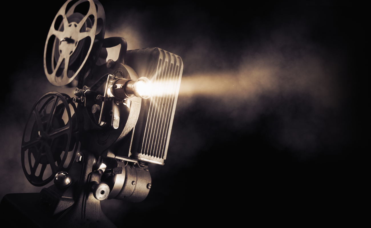Sepia image of a movie projector.