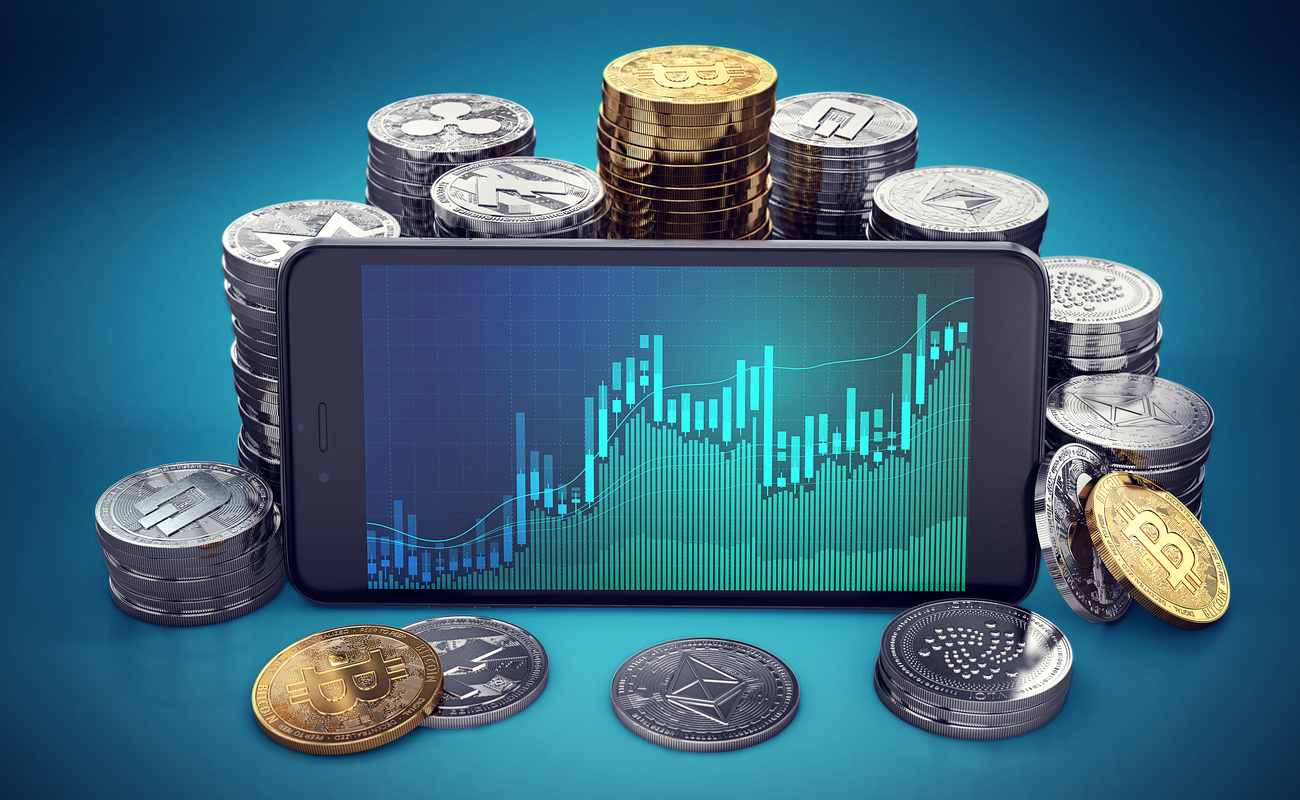 Bitcoin and altcoins with a smartphone showing a graph.