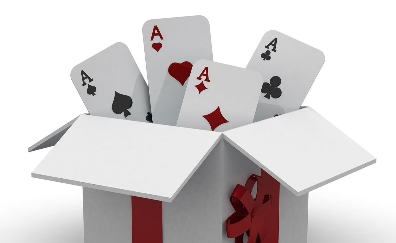 3D concept of a gift box with ace playing cards coming out of it.