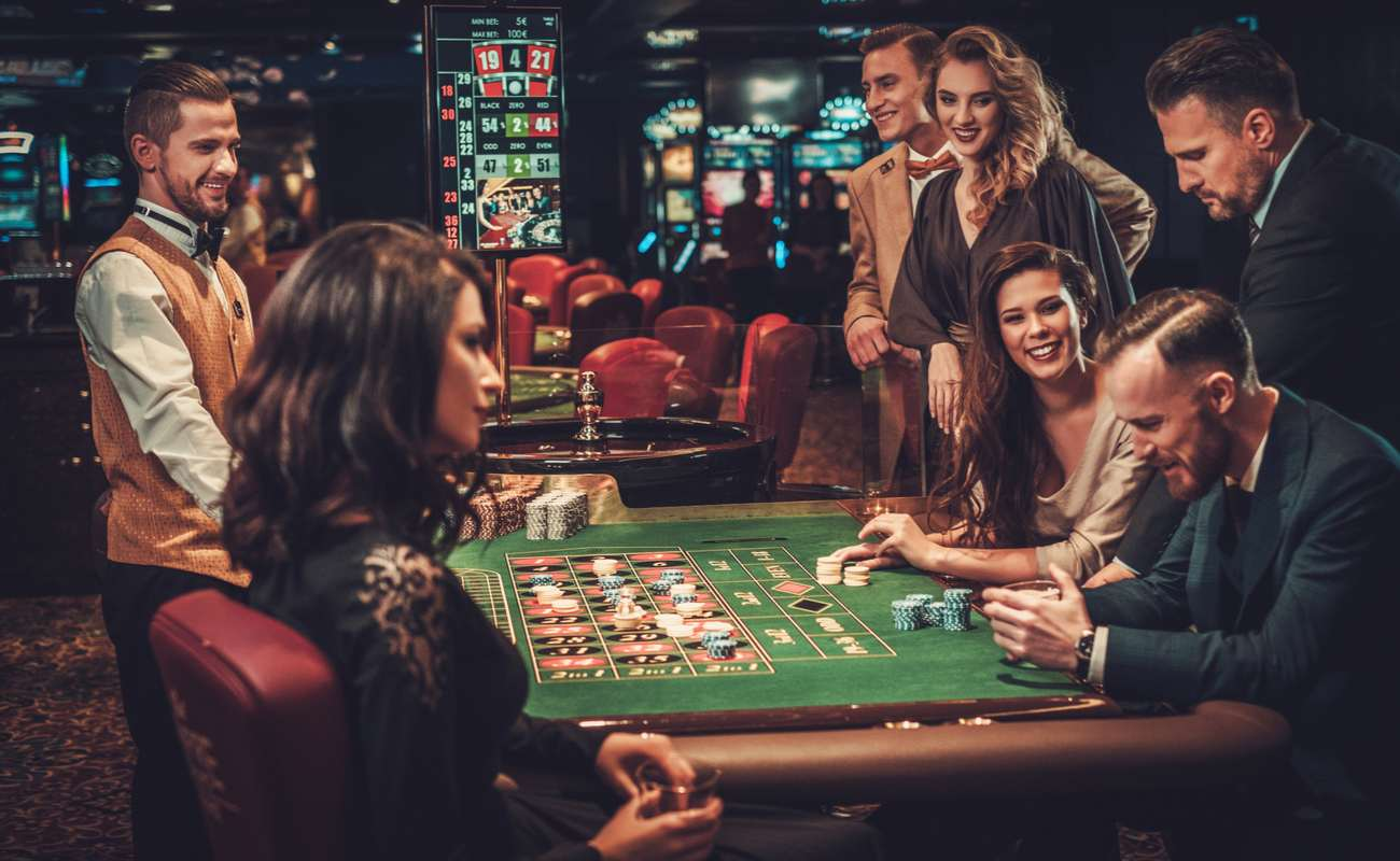 A group of friends having a good time at the casino.