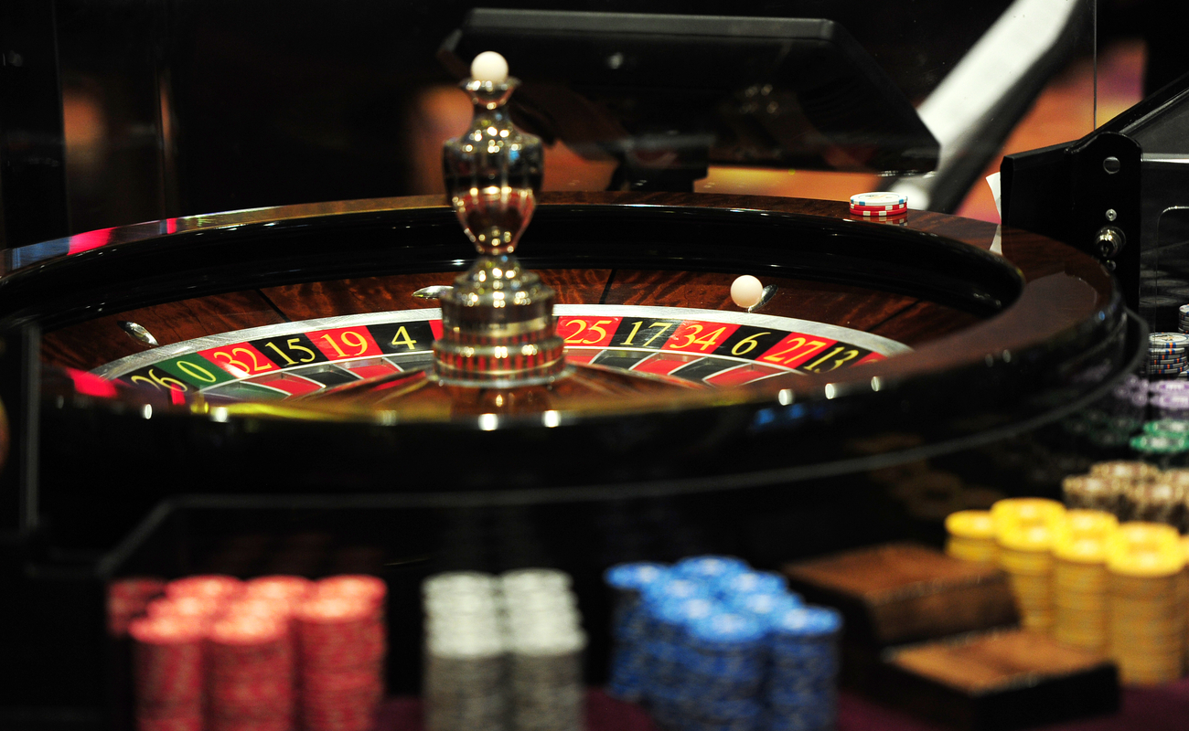A roulette wheel surrounded by casino chips.