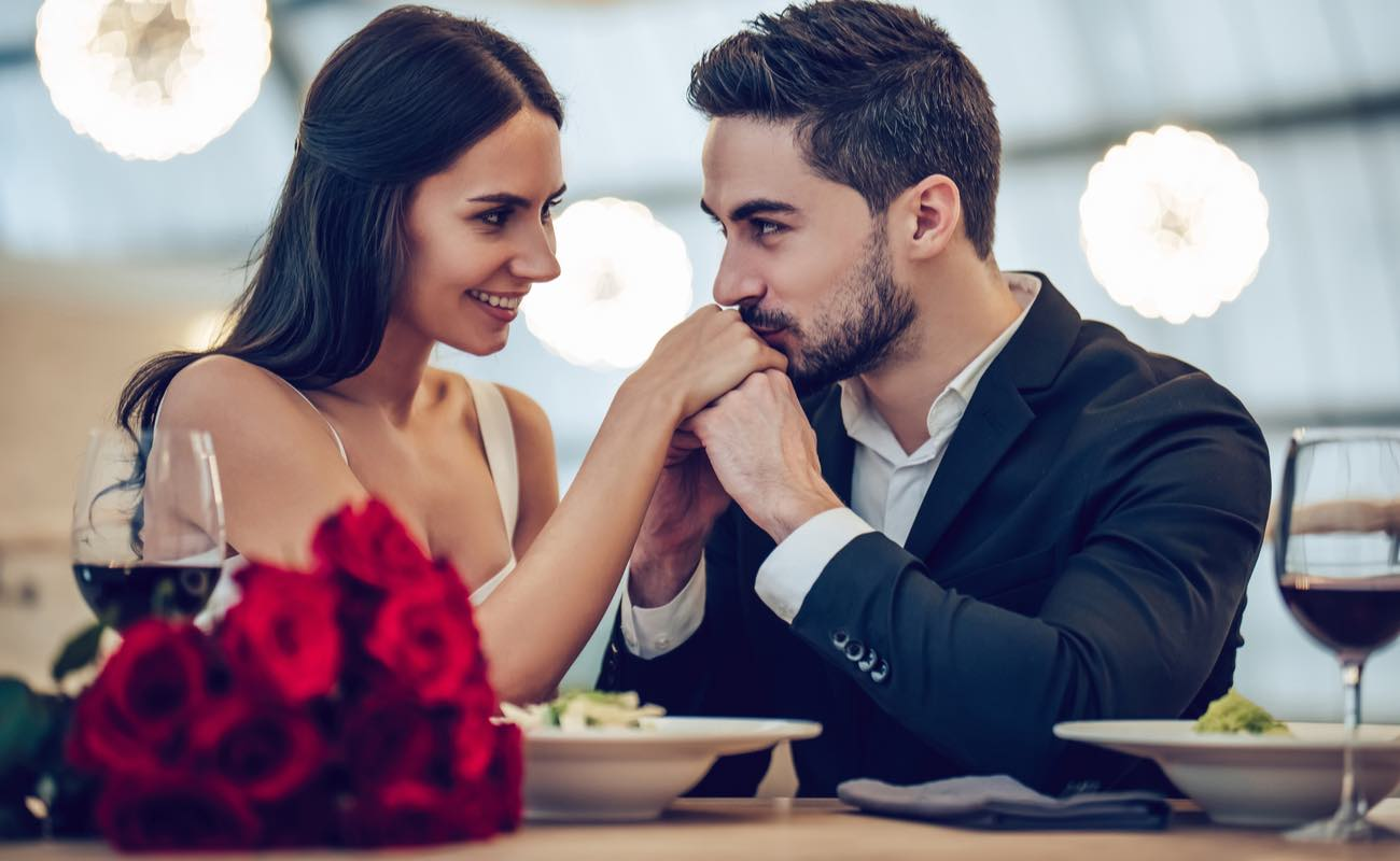 Couple at a romantic dinner looking into each other's eyes.
