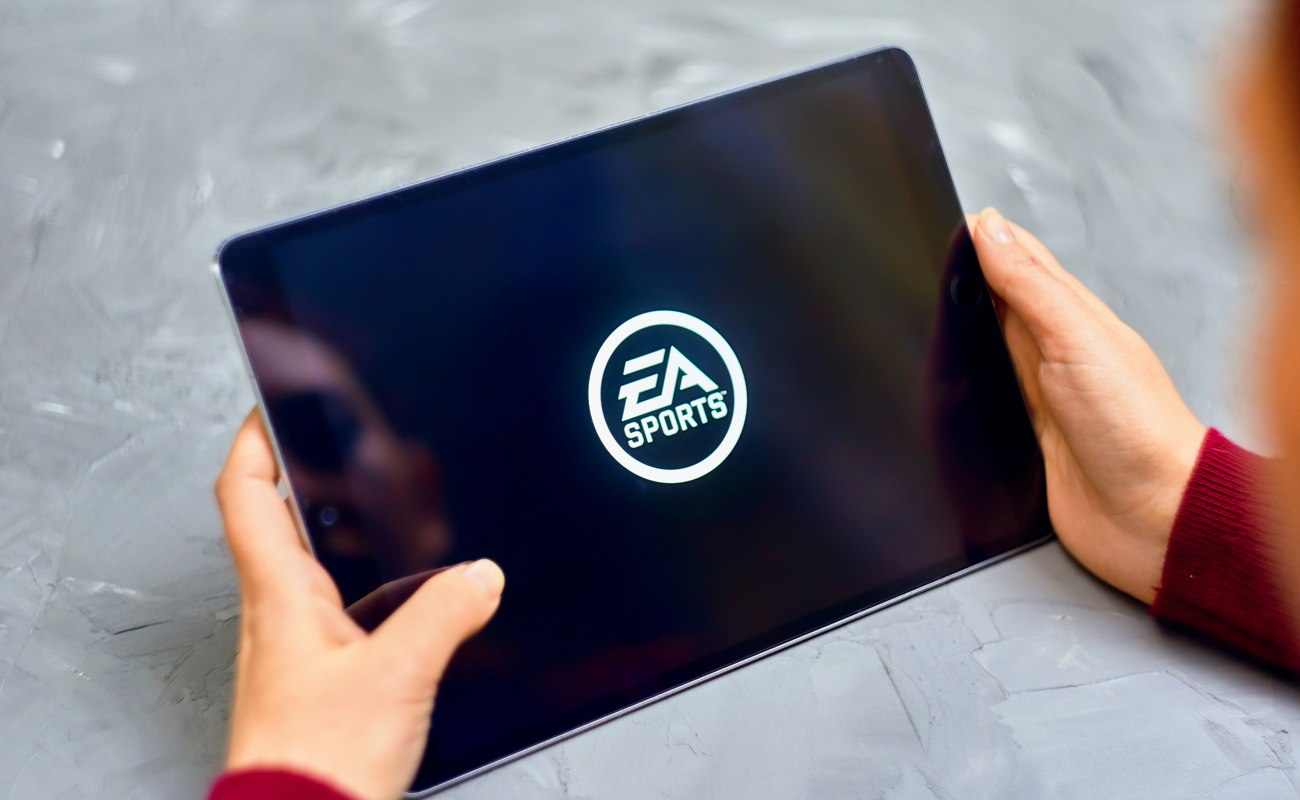 EA sports logo in white on a black screen tablet