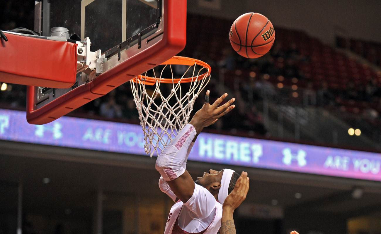 Basketball player about to catch a ball for an offensive rebound