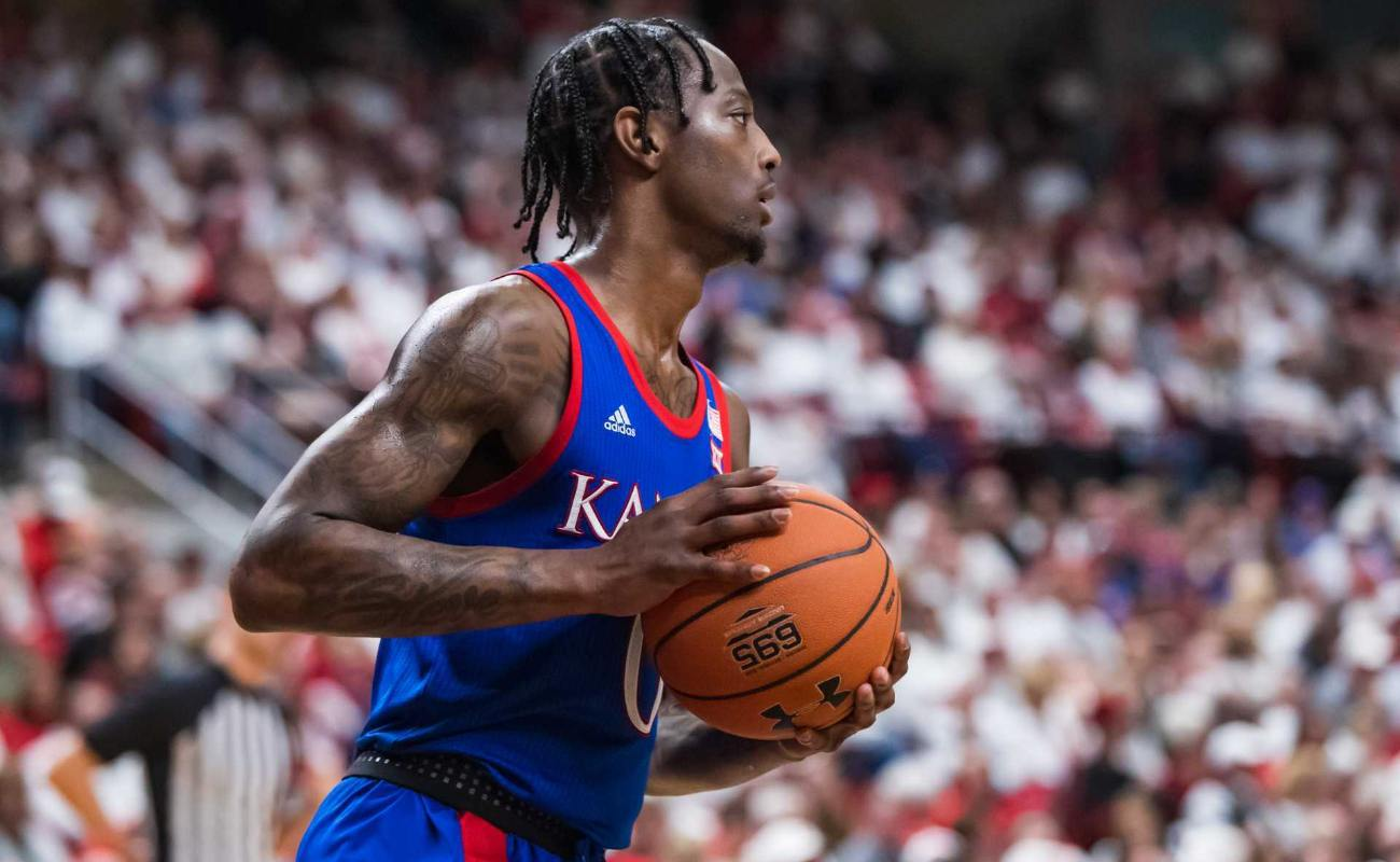 Guard Marcus Garrett of Kansas Jayhawks handles the ball during college basketball game against Texas Tech Red Raiders on March 07, 2020