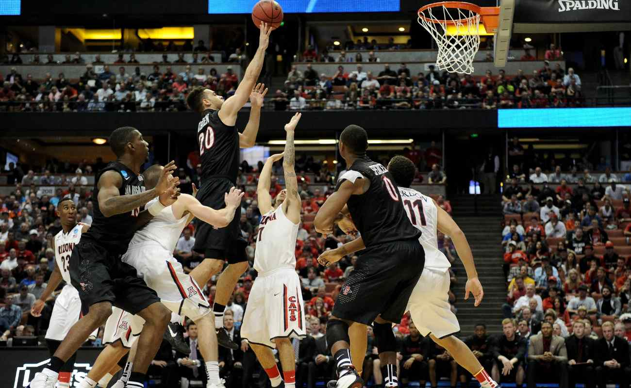 O'Brien of  San Diego State Aztecs shoots over Gabe York of  Arizona Wildcats in regional semifinal of 2014 NCAA Men's Basketball Tournament