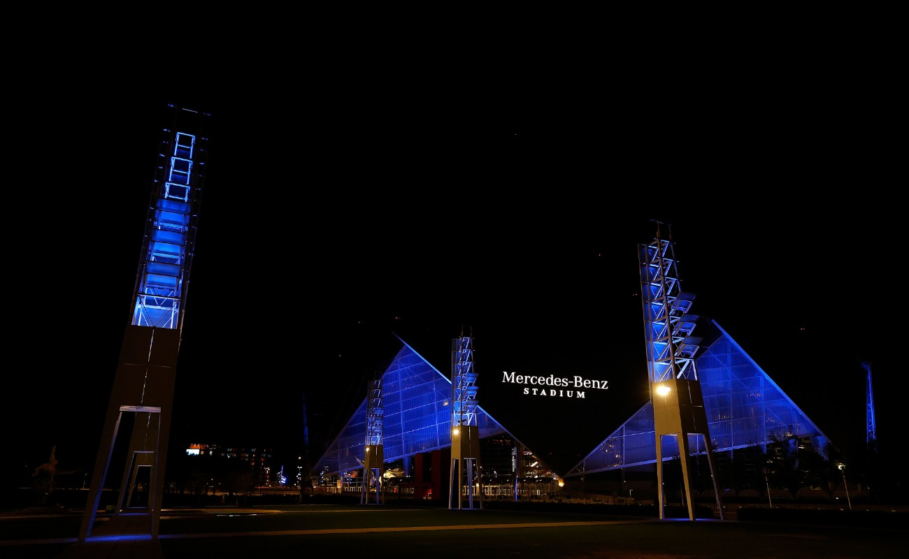 Mercedes Benz Stadium at night blue lights
