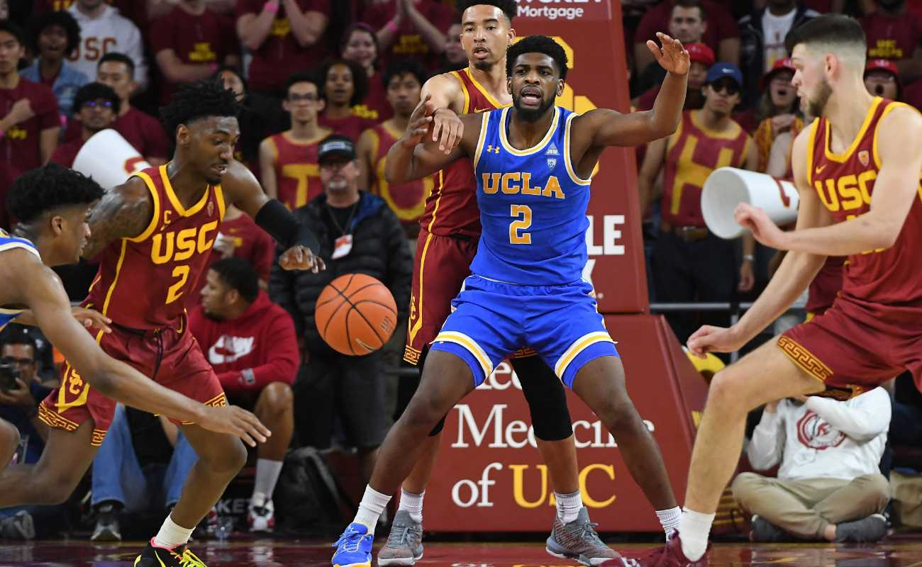 Jonah Mathews of USC Trojans chases down ball in basketball game at Galen Center