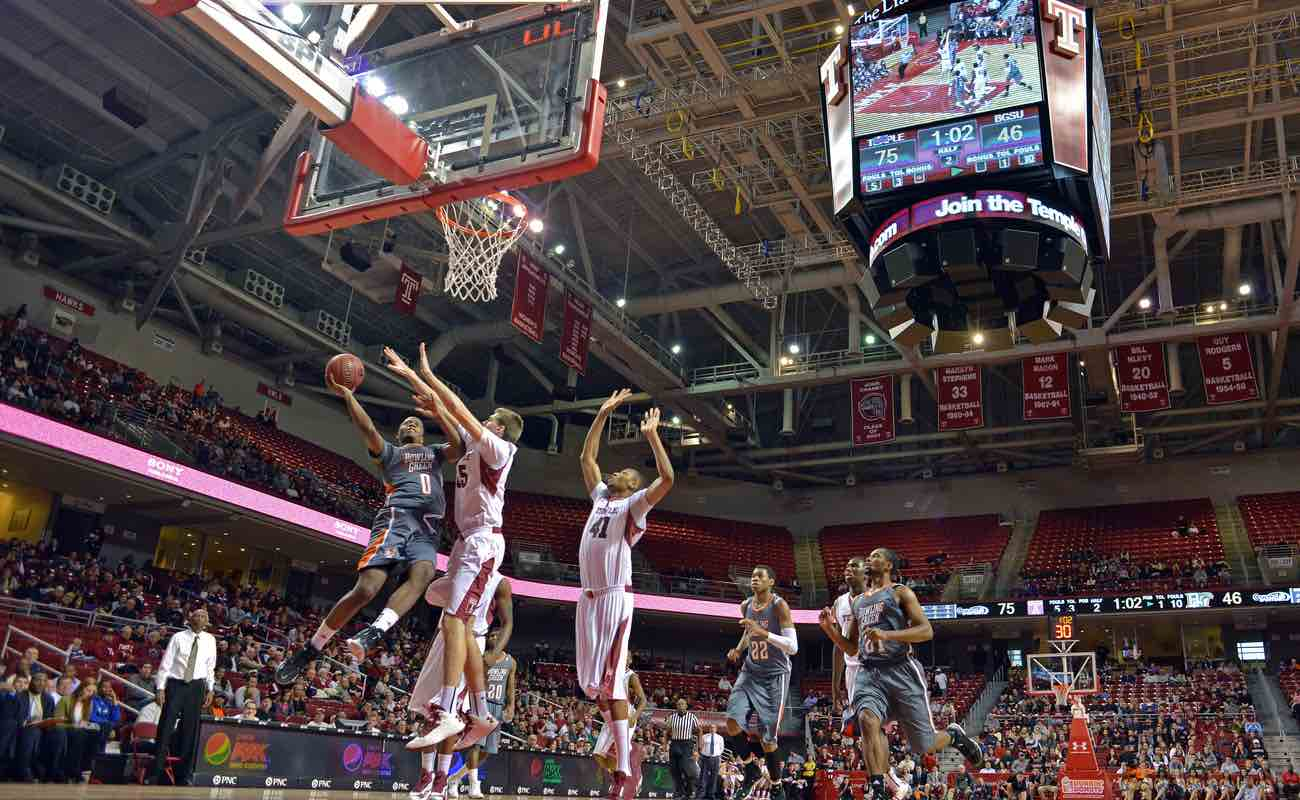 Bowling Green State University's Spencer Parker goes in for a shot as Temple player defends during a basketball game