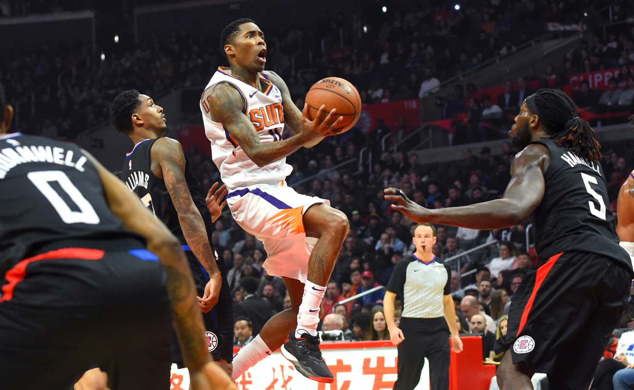 Jamal Crawford of Phoenix Sun drives basketball to the basket during game at Staples Center