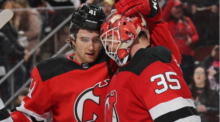 Michael McLeod and Cory Schneider of New Jersey Devils celebrate their victory over St. Louis Blues